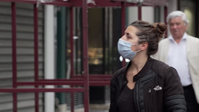 paris street scenes during coronavirus lockdown some people wear face masks - obscured face stock videos & royalty-free footage