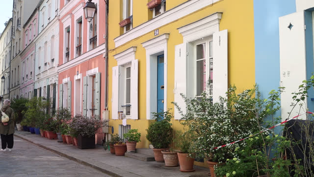 paris street with facades of colorful houses - clothing stock videos & royalty-free footage
