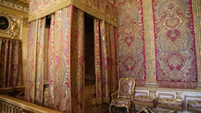 paris, the king's chamber with the canopied bed in chateau de versailles - palace video stock e b–roll