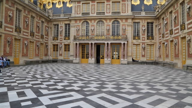paris, the main court in the chateau de versailles - chateau de versailles stock videos and b-roll footage