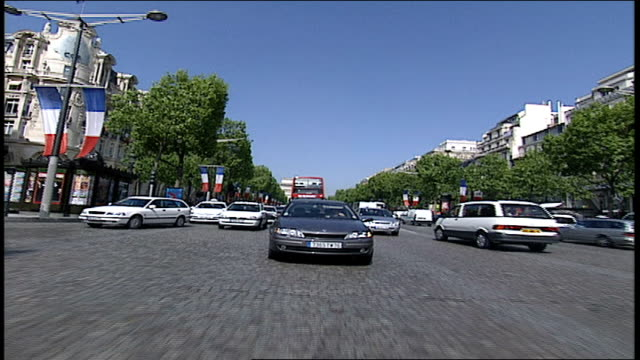 pov of paris traffic on the champs elysees - anno 2002 video stock e b–roll