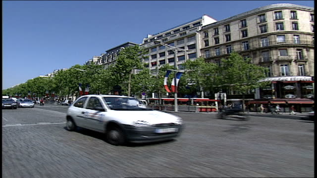 pov of paris traffic travelling on the champs elysees - anno 2002 video stock e b–roll