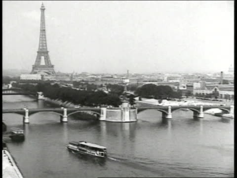 paris w/ the seine river pont sully below la tour eiffel bg xha mass of people celebrating in street w/ fountains column pan crowd of people - eiffel tower stock videos & royalty-free footage