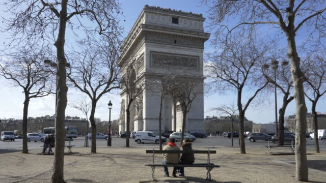 paris, winter breaks and the arc de triomphe. - arch stock videos & royalty-free footage
