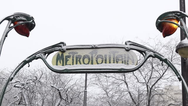 paris with snow, 2018, metro station entrance sign with snow - western script stock videos & royalty-free footage