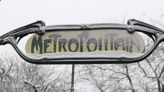 paris with snow, 2018, metro station entrance sign with snow - entrance sign stock videos & royalty-free footage