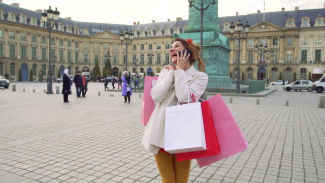Paris, Woman doing shopping on Place Vendome