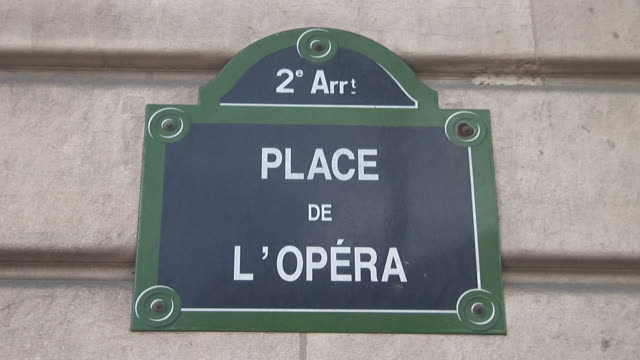 paris2e arrt place de l' opera sign in paris france - place de l'opera stock videos and b-roll footage