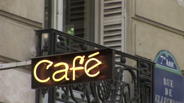 pariscafe sign in city street of paris france - cafe stock videos & royalty-free footage