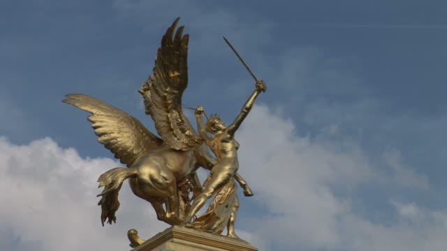 parisclose view of grand palais paris statue in paris france - grand palais stock videos & royalty-free footage
