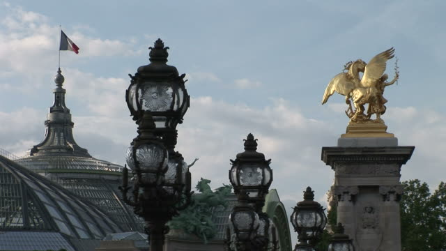 ParisGrand Palais Paris Statue and Alexandre III Bridge lamps in Paris France