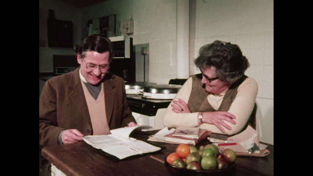 parishioner laughs with vicar, uk, 1970s - clergy stock videos & royalty-free footage