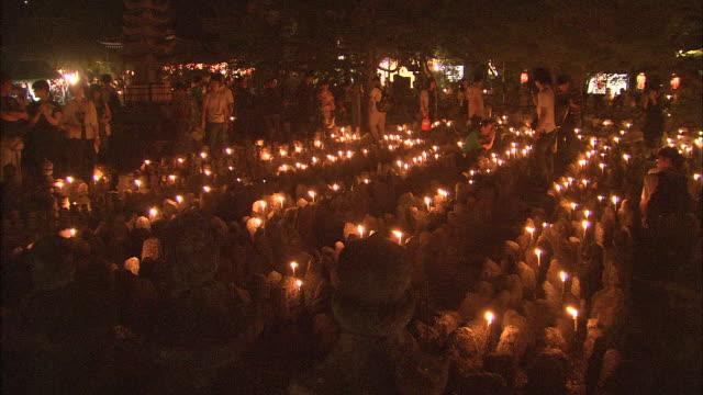 parishioners gather for the obon festival in the otagi nenbutsu-ji temple. - 盆点の映像素材/bロール