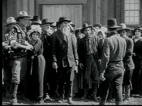1916 b/w montage ms ws parishioners walking through teasing crowd on street, two men standing face to face in saloon, 1880s / santa monica, california, usa - 1916 stock videos & royalty-free footage