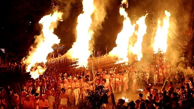 Parishioners wearing loincloths received a bit of warmth by hauling six humongous torches around Daizenji Tamataregu shrine during the Oniyo festival...