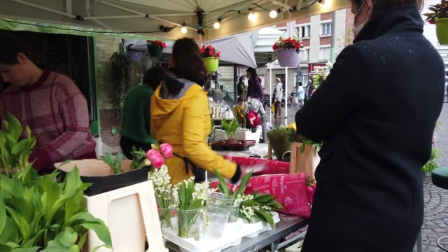 parisian florist sells lily of the valley for may 1st outside his store traditional labor day protests and rallies were canceled this week as part of... - flower shop stock videos & royalty-free footage