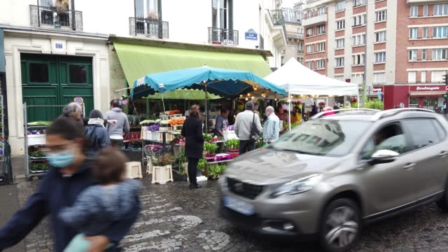 parisian florist sells lily of the valley for may 1st outside his store. traditional labor day protests and rallies were canceled this week as part... - day lily stock videos & royalty-free footage