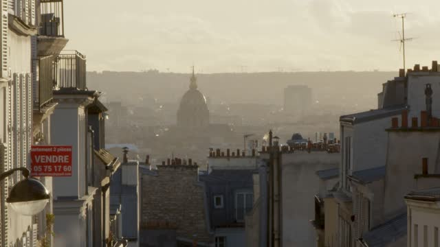 parisian street with invalides in the background. - cityscape stock videos & royalty-free footage