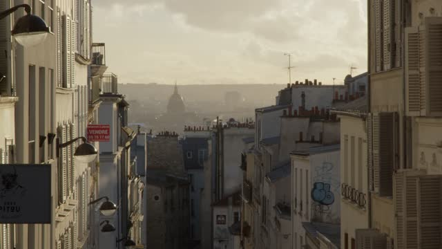 parisian street with invalides in the background. - paris france stock videos & royalty-free footage