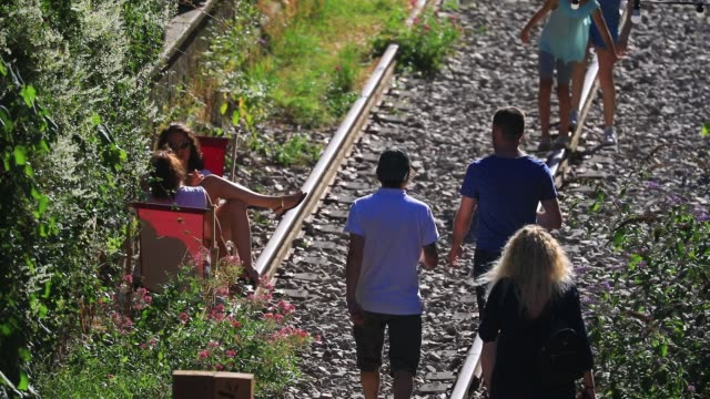 parisians enjoy a sunny summer afternoon at the paris former small belt railway on july 19, 2020 in paris, france. left fallow, the abandoned railway... - small stock videos & royalty-free footage