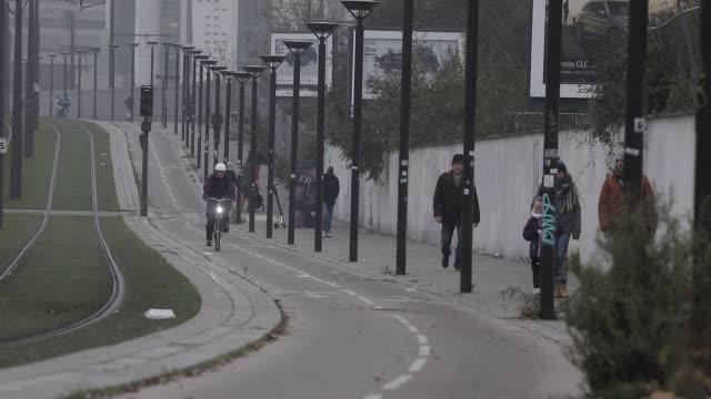 vidéos et rushes de parisians walk along a tram line during strikes and inter-professional demonstrations against pension reform in paris on december 5, 2019 in paris,... - tram