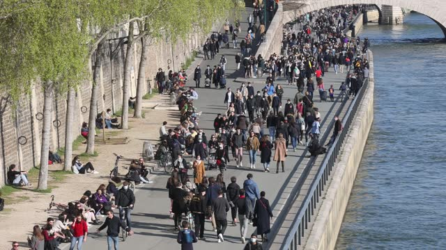 parisians walk on the seine river banks without social distancing on march 20, 2021 in paris, france. a third lockdown in certain areas of france... - illustration stock videos & royalty-free footage