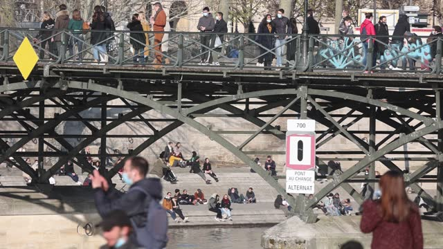 parisians walk on the seine river banks without social distancing on march 20, 2021 in paris, france. a third lockdown in certain areas of france... - tourism stock videos & royalty-free footage
