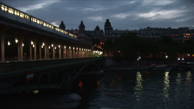 ParisMetro train on Bir Hakeim bridge at night in Paris France