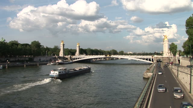 parispont alexandre iii bridge and seine river in paris france - pont alexandre iii stock videos & royalty-free footage