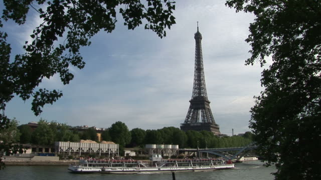 parisview of debilly footbridge and eiffel tower in paris france - barge stock videos & royalty-free footage