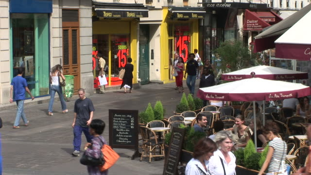 parisview of shops in city street of paris france - france stock videos & royalty-free footage