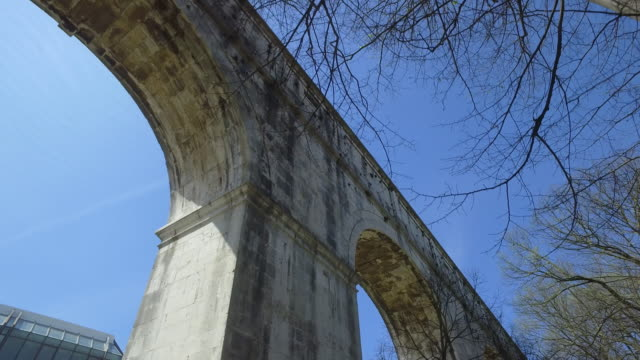 park and aqueduct in lisbon - aqueduct stock videos and b-roll footage