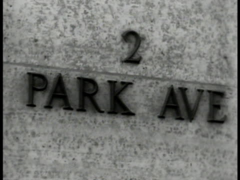 Park Avenue Building entrance CU Plaque '2 Park Ave' INT MS Chief Dr James E West at desk organizing papers VS Local Council groups in meeting New...