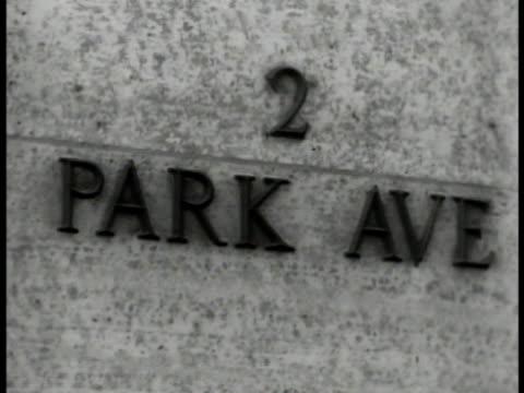vidéos et rushes de park avenue building entrance. plaque '2 park ave' int chief dr. james e. west at desk organizing papers. vs local council groups in meeting. new... - 1930 1939