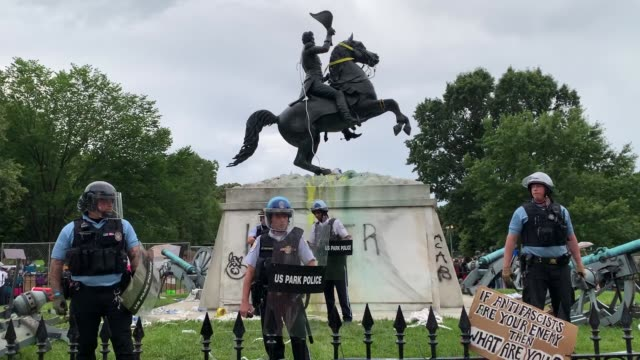 s park police keep protesters away after they attempted to pull down the statue of andrew jackson in lafayette square near the white house on june 22... - lafayette square washington dc stock videos & royalty-free footage