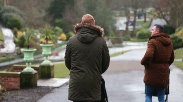 park stroll - modern manhood stock videos & royalty-free footage