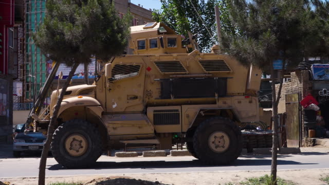 a parked armored car in kabul - convoy stock videos and b-roll footage