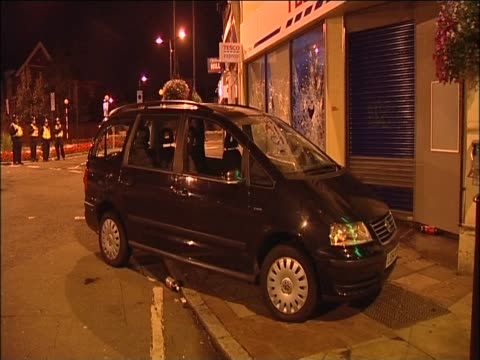 Parked car mounted on street outside Tesco after looting in the area August 2011