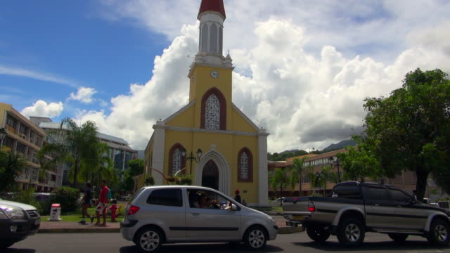 stockvideo's en b-roll-footage met parked cars in front of the church in papeete - tahiti