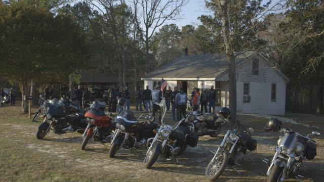 parked motorcycles outside house, with christian motorcycle club members standing and talking - motorcycle biker stock videos & royalty-free footage