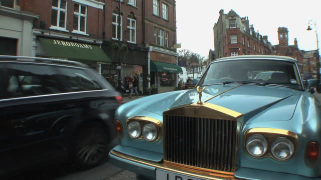 ws parked rolls royce and fancy shops on high street in hampstead / london, uk.  - rolls royce stock videos and b-roll footage