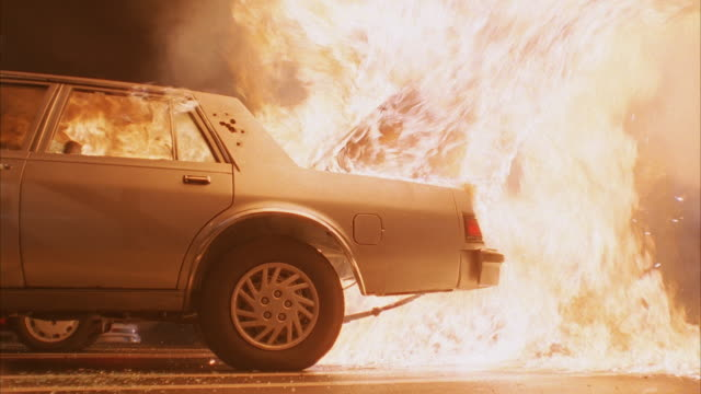 ms parked sedan car exploding and burning - stationary stock videos & royalty-free footage