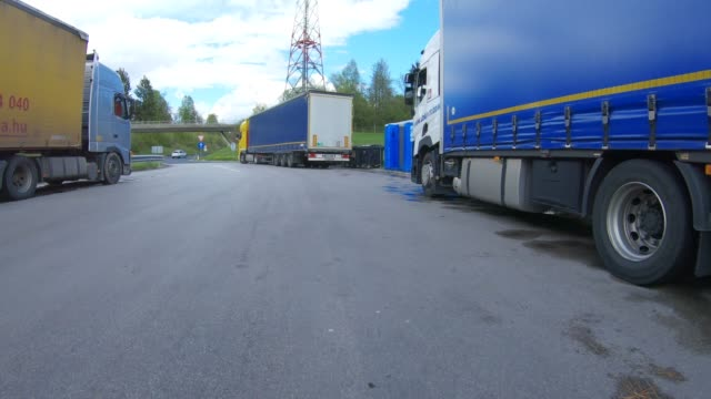 parked transportation vehicle on a truck stop during weekend restrictions - articulated lorry stock videos & royalty-free footage