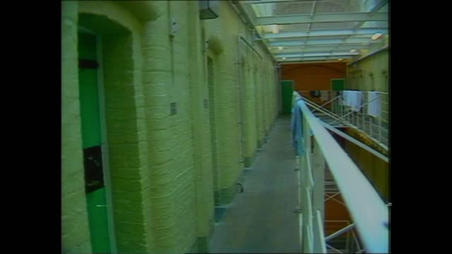 isle of wight: parkhurst: int prison block through steel netting tilt down av cell doorways l-r - doorway stock videos & royalty-free footage