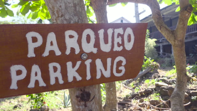 parking banner sign made of wood of a farm log cabin in nicaragua, ometepe island. - western script stock videos & royalty-free footage