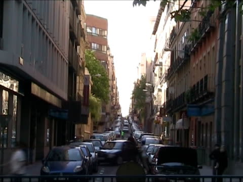parking car in narrow street - narrow stock videos & royalty-free footage