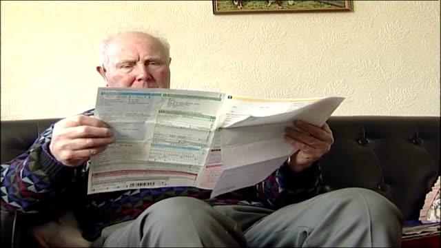 Derbyshire farmer receives London fine Derbyshire INT Eric Smart reading parking penalty notice Smart looking at registration number on vintage...