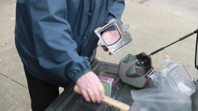 vidéos et rushes de parking enforcement officers repair pink paint and expanding foam covered parking meters on the downtown square that were discovered to be... - endommagé