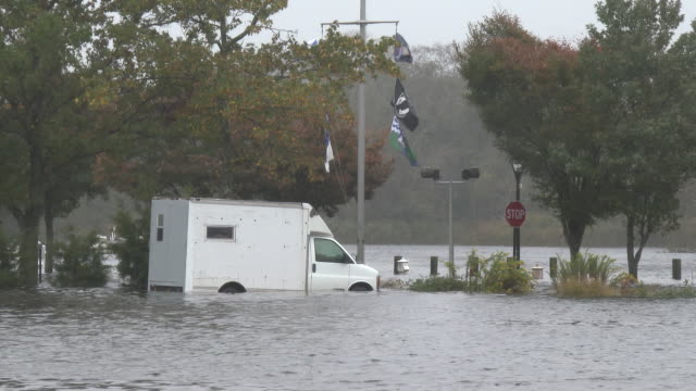 Parking Lot and Vehicle Submerged In Flood Waters