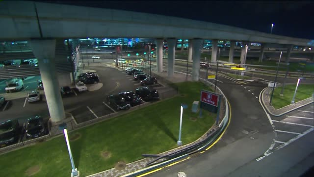 parking lot at jfk airport at night at john f. kennedy international airport on november 22, 2013 in new york, new york - john f kennedy airport stock videos & royalty-free footage